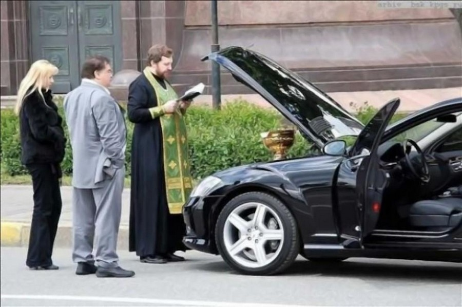 Car blessing - Orthodox priest blessing a car